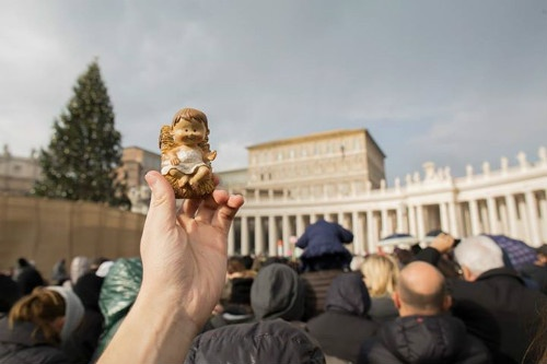 a_statue_of_the_baby_jesus_from_a_nativity_scene_is_held_up_for_the_blessing_at_st_peters_square_on_bambinelli_sunday_dec_15_2013_cna